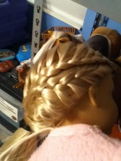 This is on an American Girl Doll, but I still like it. It's just a lace braid over a half French.