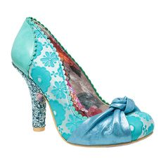 Smartie Pants Turquoise - The perfect shoe for all occasions. With a metallic blue knot detailing over the front of the toe. Turquoise flowery fabric upper and faux leather back counter with a sparkly glitter heel.