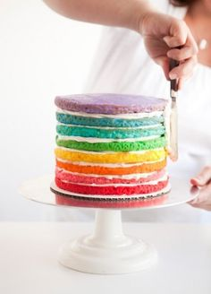 An 8 layer Rainbow Cake just as the first frosting dollop is being spread onto it. ♡