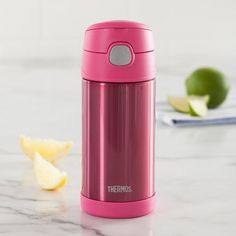 Say hello to refreshment with a Thermos Funtainer Insulated Sport Bottle! This stainless steel vacuum insulated sport bottle keeps your beverage cool for 12 hours! The twist on lid features a button push pop top and built in straw for easy drinking without spills!