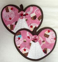 Light pink cupcake hot pad pair with cherries sprinkles and polkadots. Perfect for your cupcake themed kitchen could be used on a daily basis or just for decoration.  A personal favorite from my Etsy shop https://www.etsy.com/listing/226438800/pink-cup-cake-heart-hot-pad-pair