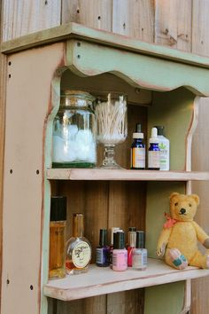 Our cute shelf painted and distressed in sage green and buttermilk combined.  Love the combo.