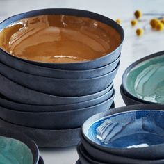 Relish the bounty of summer all year round with our new range of Yalta Bowls and Planters available three trending colours: Indigo, Sage and Ochre. The majesty of natural imperfection is brought to life in these ceramics in both the crockery and planters. The crockery range consist of a snack bowl and generous pasta bowl made from black clay with wiped edges to expose the natural clay. The Summer Planters are made from Stoneware with slip cast black exposed bottoms. Hertex Fabrics, Dining Ware, Snack Bowls, All Year Round, Black Clay, Color Trends, Stoneware, Im Not Perfect, It Cast