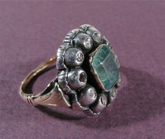 #18783, front details of emerald and diamond ring, engraved verso seen in other shots; 2009