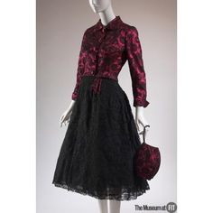 Designer: Mainbocher, 1891-1976. Medium: Black Chantilly lace, chiffon, and fuchsia satin. Date: c.1955-1957  Country: USA. —The Museum at Fashion Institute of Technology —Online Collections