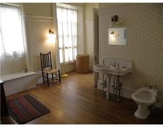Huge bathroom with hardwood floors. And a bidet!