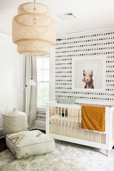 Love the moon phase wall paper! And the camel print cracks me up. Wonder what baby would think of it! And the pops of gold (or mustard yellow?) in this neutral nursery are great!