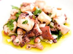 Octopus Salad - This is a light salad very much appreciated in Portuguese cuisine. The octopus, the main ingredient, is cooked and diced. It is served in small dishes and accompanied by onion, garlic, coriander and olive oil.