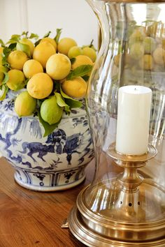vignette with Blue and White bowl, lemons and a hurricane lantern