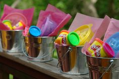 A bucket, Play-Doh and some shapes and you have a great and inexpensive party favor