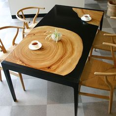 I really want to make this. Tree ring within black tabletop.