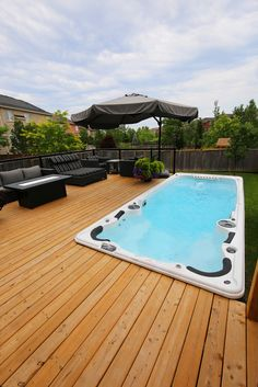 Another great example of how you can get the inground pool look by installing your swim spa beside your deck