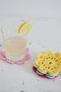 How to make crochet flower coasters - cute!  and I just bought some yarn yesterday that would be perfect!
