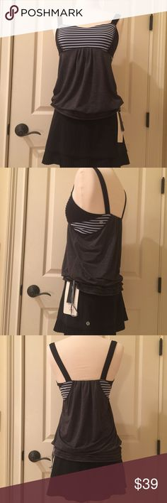 Lululemon size 6 workout top with built in bra Lululemon size 6 workout top with built in sports bra. In excellent used condition. Skirt in picture us also for sale lululemon athletica Tops Tank Tops