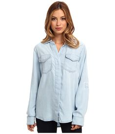 Heritage charm meets contemporary design in this standout Sam Edelman button up.Chambray shirt boasts pieced panels at vented shirttail hem.Spread collar.Bias-cut flap pockets at chest.Concealed button placket.Long sleeve sport a button tab roll-up feature.Two-button cuffs.Box pleat at straight back yoke.100% lyocell.Machine wash cold, tumble dry low.Imported. Measurements:Length: 28 inProduct measurements were taken using size SM (US 4-6). Please note that measurements may vary by size.