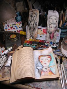 Create an art journal by painting over pages in a book.