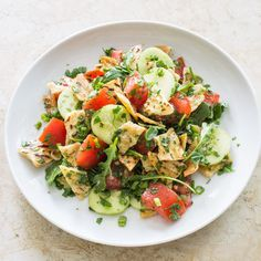 Pita Bread Salad with Tomatoes and Cucumber (Fattoush) for Two.  From Cook's Illustrated.