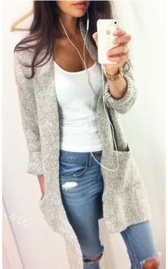 Off duty style. Ripped jeans, white vest, oversized cardigan. Selfie, brunette