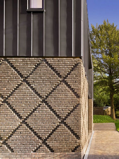 MATT Architecture, Black zinc cladding and handcrafted black bricks in a diaper pattern. Detail Architecture, Brick Architecture, Futuristic Architecture, Amazing Architecture, Zinc Cladding, Brick Cladding, Brick Design, Facade Design, Brick Extension