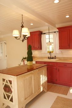 Red Kitchen Cabinets. I just wish the island had red cabinets too.