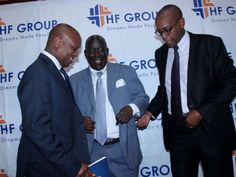 Housing Finance managing director Sam Waweru,Group chairman Steve Mainda and the group managing director Frank Ireri after the group AGM held at KICC in Nairobi. Photo/Enos Teche.