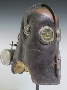 VAJEN BADER SMOKE HELMET The Vajen Helmet revolutionized firefighting in the late 19th c. Allowing firemen to carry their own oxygen supply and giving full protection to the men from smoke and falling debris. Made in Indiana the mask label lists patents from 1891 to 1900. It is the science fiction aspect of it that captures the imagination. The round eyes have mica for fireproof viewing and even condensation wipers. This example is in remarkable condition. ht on base 23 in. 18.5 x 10 x 16…