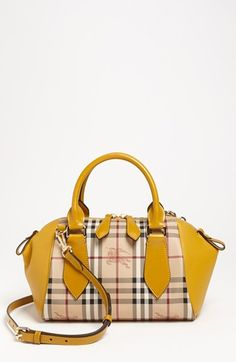 Little pop of color on this Burberry bag. @Nordstrom