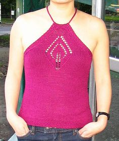 This halter is the perfect summer top. The cotton blend keeps you cool, while the halter shape shows off tanned shoulders. The candlelight lace panel on the front is adapted from the candlelight #2 pattern in Barbara Walker's 2nd Treasury of Knitting Patterns. It makes a perfect introduction to lace knitting and chart reading, and the detail gives the halter that little bit of extra interest. It's light and airy for day, but the slight shine from the silk content in the yarn makes it…