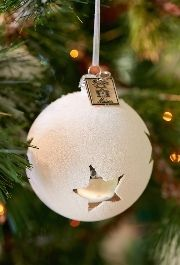Simple ornaments bring a touch of elegance to a Christmas Tree.