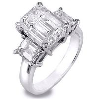 This beautiful diamond engagement ring has an elegant design that is both timeless and classical. Its everlasting style is complemented by a glittering emerald cut diamond with a weight of 3.01 carats. This diamond radiates with fire and has a clarity of VVS2 and a color grade of H. Hugging each side of the centerpiece are additional emerald cut diamonds that total 1.02 carats. The side diamonds range in clarity from Vvs1-Vvs2 with a color grade of G-H. The classical looking setting is made…