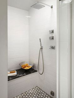 A small shower gets all the bells and whistles with body jets, a rain showerhead, and a handheld wand. Less square footage to eat up a tile budget allows for these luxurious add-ons.
