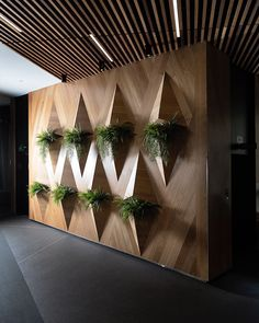 We love this structured vertical garden design the @parkerroadau creative team put together for @lkpropertygroup. Something so simple yet so aesthetically appealing! Call us today to see how we can help you reinvent your space - (03) 8288 2677 @grahamgee #parkerroad #lkpropertygroup #verticalgarden #verticalgardendesign #officefitout #corporatestyling #corporate #officedecor #officedesign #urban #urbandesign #interiordesign #artificialplants #greenery #melbournedesign