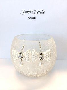 Vintage Pearls, Beaded Bow Tie Earrings, Wedding earrings, Bridal earrings, Beadwork , Bow Tie Earrings, dangles, Bow Ties, Rhinstone by JamieEstelleJewelry on Etsy https://www.etsy.com/listing/538126953/vintage-pearls-beaded-bow-tie-earrings