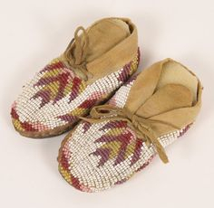 Northern Plains beaded buckskin baby moccasins,$225.00