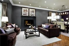 The array of grays, black, and mauve make for a grown-up (but not stuffy) sitting area.