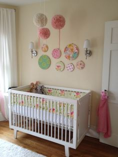 Nursery wall decorated with embroidery hoops and fabric