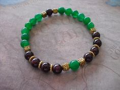 Buy Red Garnet & Green Emerald Bracelet by shynnasplace. Explore more products on http://shynnasplace.etsy.com