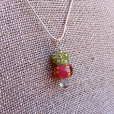 "Pink Lampwork Bead and Peridot Gemstone Cluster Pendant Sterling Silver Necklace. Magnolia Jewel Designs.  SALE!  A break in the April clouds- get 20% off for the rest of the month with the coupon code ""APRIL20"".  Vaild at our new website magnoliajewel.com, too."