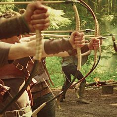 Tanna and Tauriel in archery (The Darkstone by Moriah Quint)
