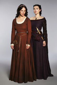 The maroon gown represents the styling of Litellana in present day. The purple gown represents her Aunt Lady Dala and her upstanding, stern manner
