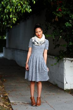 like the simplicity of the dress - easy to accessorize and balances out the shoulders