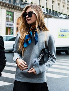 Silk scarf with a casual grey sweatshirt - Parisian street style perfection.