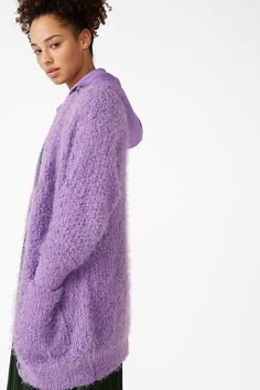<p>Comfort and style are havin' a party - you're invited. This oversized cardigan is ultra-cosy with a tiny bobble texture and fluffy threads. There's a det