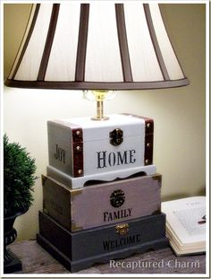 Wow - made with dollar store craft boxes, a little clay for weight, some paint, stencils, and fun stuff!  http://www.recapturedcharm.com/2011/10/craft-box-lamp.html