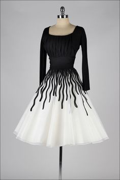 Vintage 1950's Black and White Ribbon Work Cocktail Dress   From a collection of rare vintage evening dresses at https://www.1stdibs.com/fashion/clothing/evening-dresses/
