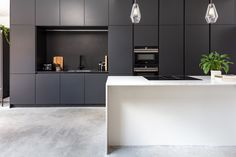 Black Kitchen furniture coupled with Siemens appliances and a concrete floor create a sophisticated and sleek kitchen, dining and entertainment space. Concrete Kitchen Floor, Kitchen Flooring, Kitchen Dining, Concrete Floors, Black Kitchen Furniture, Kitchen Interior, European Kitchens, Black Kitchens, Handleless Kitchen