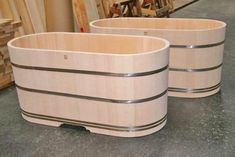 Hinoki wood tubs with stainless steel support bands, Bartok Desgin