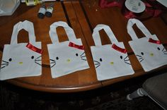 Hello Kitty Gift Bags- DIY Hello Kitty gift bags made with canvas bags, Roll of red ribbon, black puff paint, yellow puff paint, and a glue gun. Total Cost: $26 for 15 bags