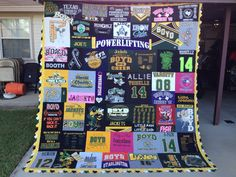 Allie's Senior T-Shirt quilt. This is the biggest and heaviest blanket I have made. It contains her favorite tees and cheerleader uniforms from Jr High to High School.