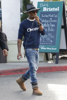 Pharrell is wearing a Chanel sweatshirt and pearls!